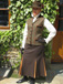 J 34 single breasted gillet Brown velvet trim with desert gold piping Shown with toning skirt.jpg