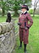 Maple leaf tartan double breasted slanted front jacket with navy velvet trim Shown with matching cropped trousers.JPG